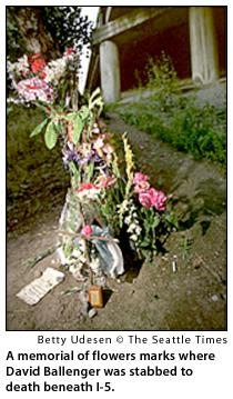 A memorial of flowers marks where David Ballenger was stabbed to death beneath I-5.